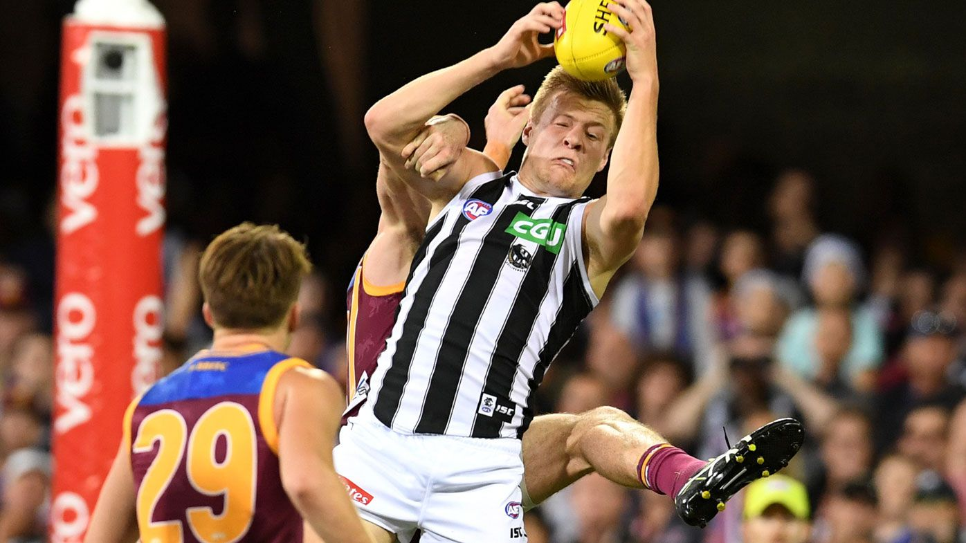 Magpies sneak past Lions in AFL