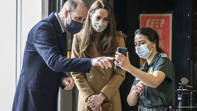 Britain's Prince William and Kate, Duchess of Cambridge talk with the family of paramedic Jahrin (Jay) Khan via a mobile phone, during a visit to Newham ambulance station, in East London, Thursday March 18, 2021.