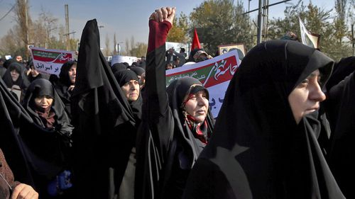 Iranian protesters chant slogans at a rally in Tehran, Iran. (AAP)