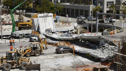 The new pedestrian bridge that was under construction collapsed onto a busy Miami highway last Friday (AAP).