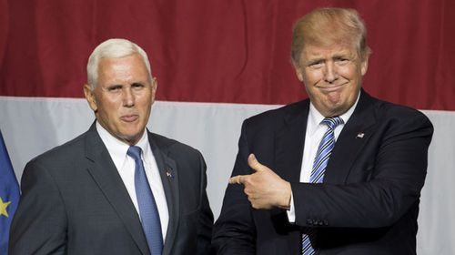 The awkward marriage... Trump, known for his anti-establishment rhetoric, and the GOP's heartland candidate. (AFP)