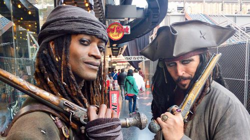"""Mr Ansalvish, who is dressed as """"Pirates of the Caribbean"""" character Jack Sparrow, is part of a bevy of costumed characters who wanders the boulevard. (9NEWS/Ehsan Knopf)"""