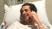 Andy Lee proves dedication to his job, does interview from hospital bed