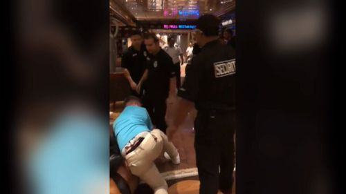 Passengers on-board a Carnival Cruise liner in the South Pacific have been filmed in a violent mass brawl (Supplied).