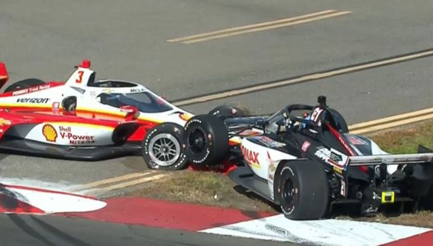 Scott McLaughlin (left) crashes out of his IndyCar debut in Florida.