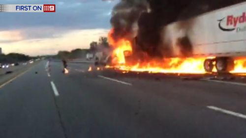 Despite being on fire for around 45 seconds, the driver managed to escape with only minor injuries. (9NEWS)