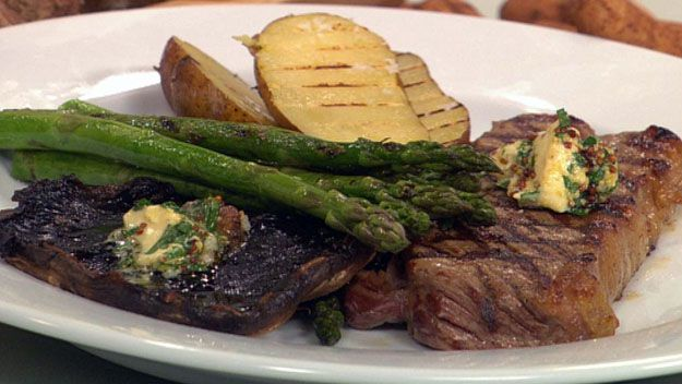Steak dinner with grilled potato, mushroom and asparagus