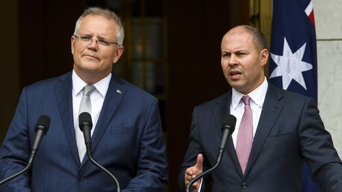 Australian Prime Minister Scott Morrison and Federal Treasurer Josh Frydenberg speak about the government's bushfire response at Parliament House in Canberra.