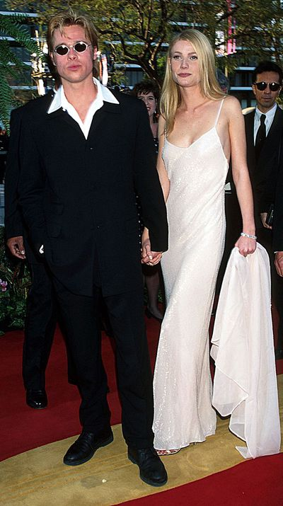 For her first Oscars, Gwyneth wore a Calvin Klein slip dress accessorised with Brad Pitt.