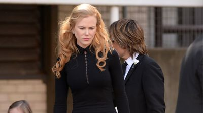 The Oscar-winner cuts a sombre figure at the funeral for her father after his sudden-death last week.