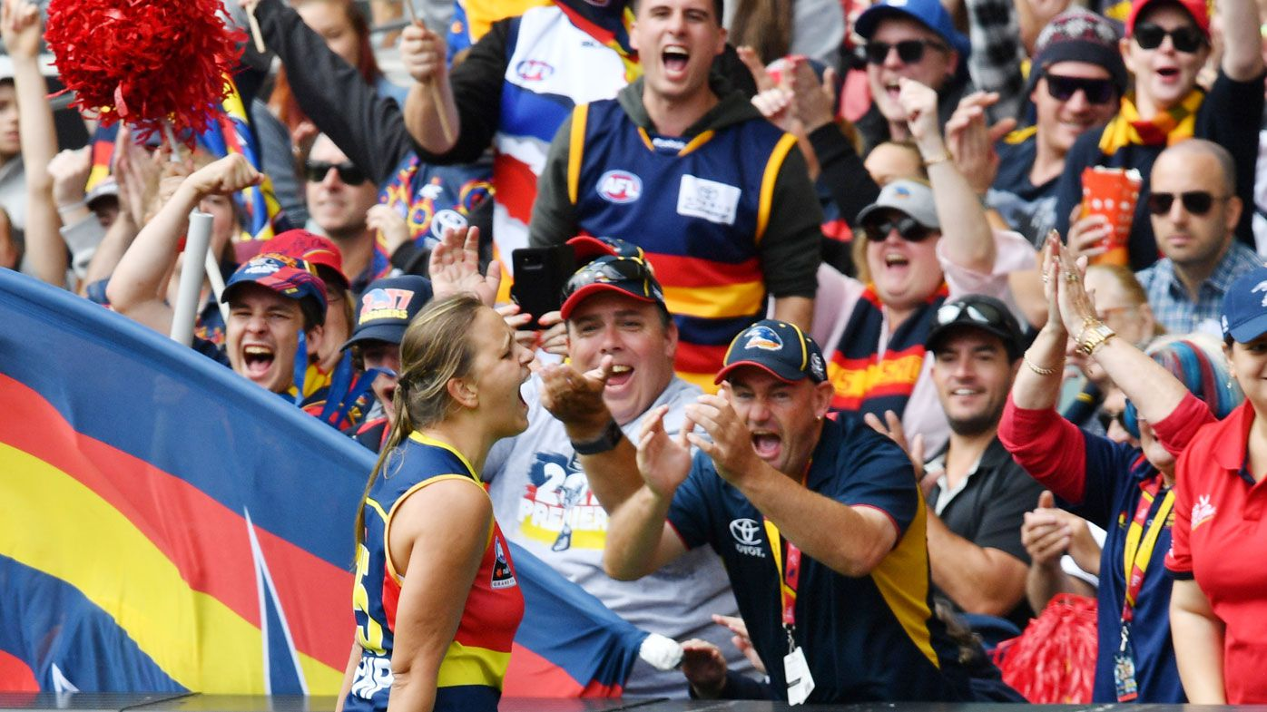 Danielle Ponter of the Crows celebrates after scoring a goal