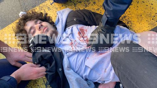 Mert Ney is held down and searched by police following a stabbing rampage in Sydney's CBD.