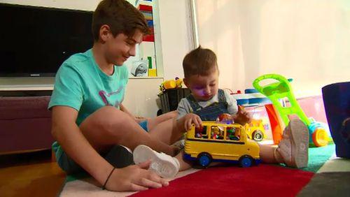Jonathan Daolas, 13, with his baby brother Jacob.