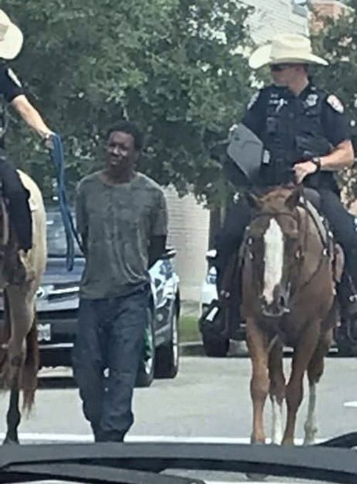 Donald Neely was led by a rope down a street in Galveston by police.