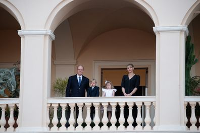 The family viewed the festivities from the palace balcony.