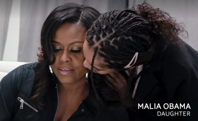 Michelle Obama hugged by daughter Malia in Becoming