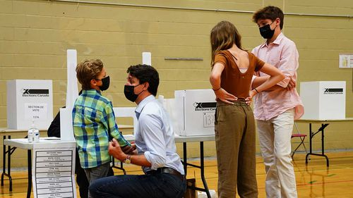 Justin Trudeau at the polling station with his three children.