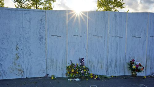 The sun sets behind The Wall of Names at the Flight 93 National Memorial in Shanksville, Pennsylvania.