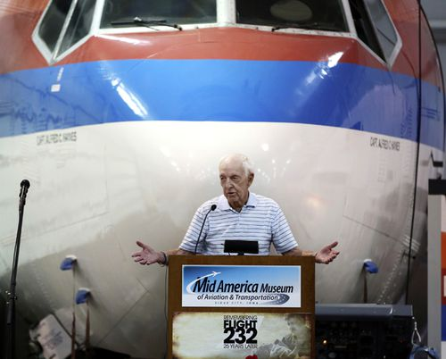 In this 2014 photo, former United Airline Captain Al Haynes speaks during a ceremony commemorating the 25th anniversary of the United Flight 232 crash, in Sioux City, Iowa. Haynes, a pilot credited for saving the lives of nearly 200 people by guiding a damaged passenger jet into a crash landing at an Iowa airport in 1989, died on August 25, 2019. He was aged 87.