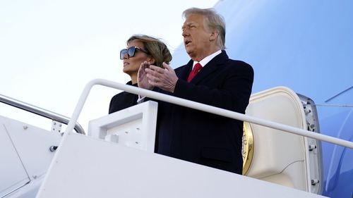 President Donald Trump and first lady Melania Trump board Air Force One at Andrews Air Force Base, Md., Wednesday, Jan. 20, 2021