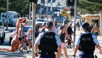 Police in Sydney patron Coogee Beach in Sydney on Easter Sunday, April 12, 2020.