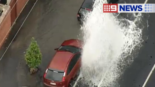 Burst water main sends water and rocks flying into air in Melbourne