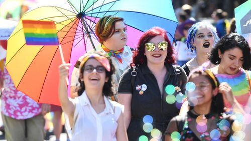 Attendees of the Midsumma Pride March are seen along Fitzroy street in St Kilda, Melbourne today.