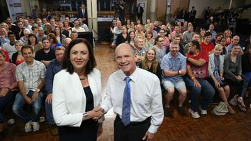Queensland Opposition leader Annastacia Palaszczuk and Premier Campbell Newman pose before the leaders debate. (AAP)