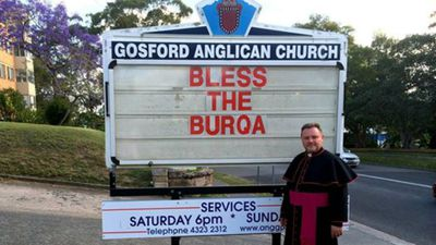 Fr Rod Bower calls on parishioners to bless the burqa. The outspoken Central Coast archdeacon has become famous online for his church signs and his forward stance on social activism.
