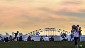 Sydney residents make the most of a sunny day in Dover Heights.