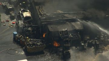 A scrap metal worker was seriously injured when the Maddington warehouse went up in flames.