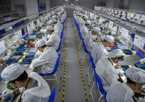 Workers assemble parts for e-cigarettes on the production line at Kanger Tech, one of China's leading manufacturers of vaping products.