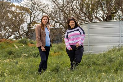 Kate and Tanya in front of the Hook family's water tank.