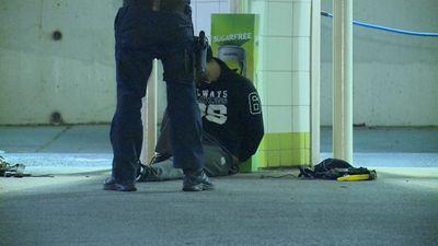 Men 'siphoning fuel' arrested at service station