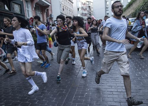 Members and sympathisers of the LGBTI (lesbian, gay, bisexual, transgender, and intersex) run as Turkish riot police use plastic bullets after the Gay Pride march event in Istanbul, Turkey.