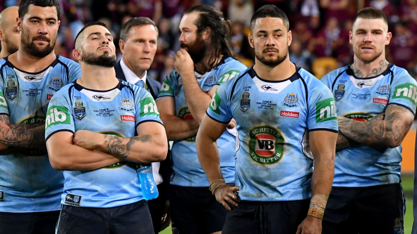 Dejected NSW players watch on