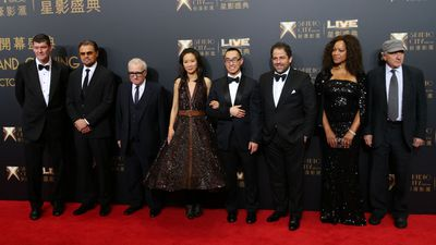 From right, film stars Robert De Niro, his wife Grace Hightower, producer Brett Ratner, Melco Crown Entertainment's CEO, Lawrence Ho, his wife Sharen Lo, director Martin Scorsese, film star Leonardo DiCaprio and James Packer.