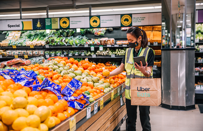 Woolworths personal shoppers collecting groceries for Uber Eats