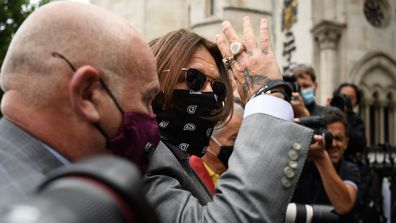 Actor Johnny Depp speaks to supporters and well-wishers as he arrives at the Royal Courts of Justice, Strand on July 16, 2020 in London, England.