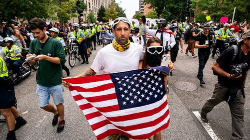Some members of the alt-right carried American flags.