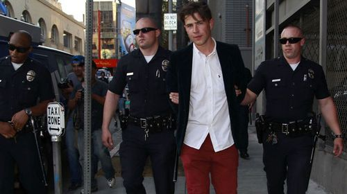 The alleged offender, believed to be Vitalii Sediuk, led away by police. (Splash)