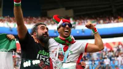 Iran fans celebrate their team's win.