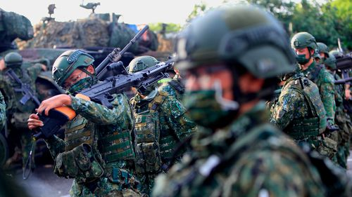 Taiwanese soldiers are seen holding grenade launchers and machine guns and driving tanks, during an operation as part of the 37th edition of the HanKuang military exercise, in Tainan, Taiwan, 14 September 2021. Training including risks assessment and monitoring of enemies have been conducted in the face of the intensifying #threats from China, with the US offering arms sale to the self-ruled island, whilst the island has been building better relations with Japan and other European countries such