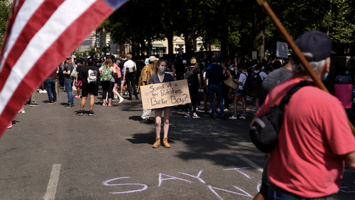Demonstrators protest, Thursday, June 4, 2020, near the White House in Washington, over the death of George Floyd. (AP Photo/Evan Vucci)