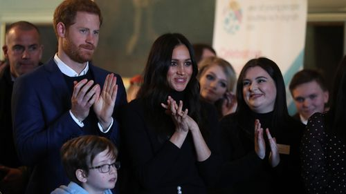 Prince Harry and Meghan Markle during a reception for young people at the Palace of Holyroodhouse. (AAP)