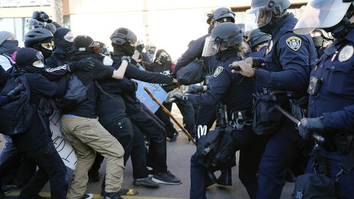 San Diego police clash with protesters after a gathering was declared an unlawful assembly.