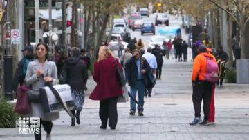 People walking along the street.