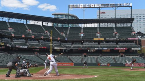 'Today's official paid attendance is ... zero': Baltimore Orioles play to empty stadium amid violent riots sweeping city