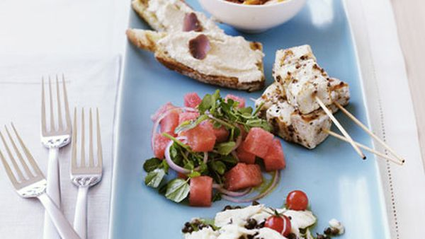 Taramasalata toast (pictured with school prawn saganaki, swordfish kebabs with watermelon salad and crab salad with cherry tomatoes and capers)