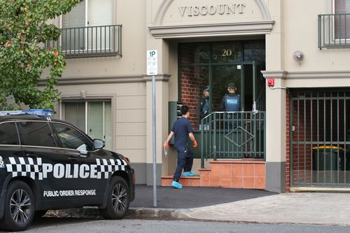 Officers remain on guard at a Bedford Street address after two people were arrested in a counter terrorism operation by Victoria Police.